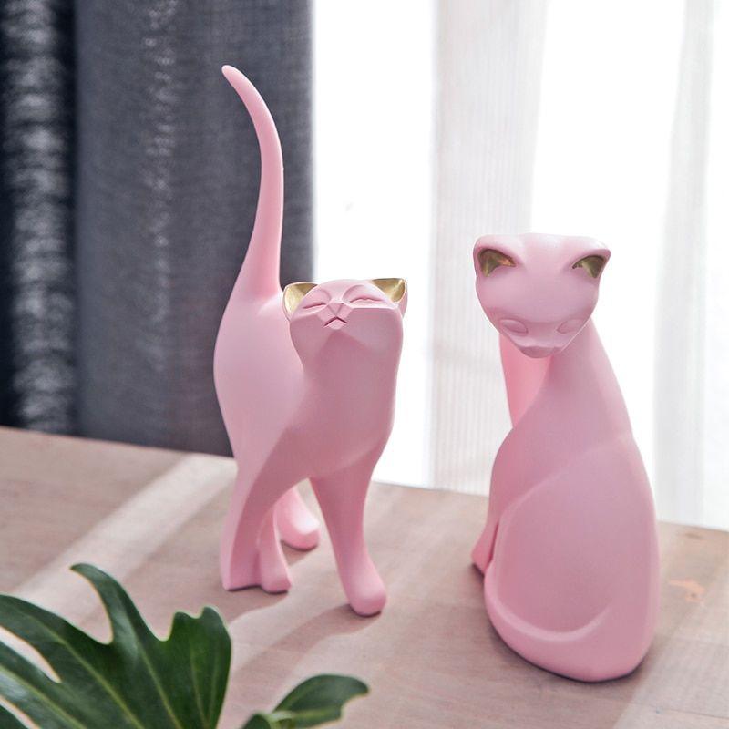 Chat en résine rose